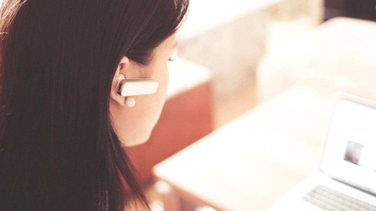 woman with bluetooth earpiece